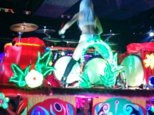 a kick as drummer playing on a spinning platform