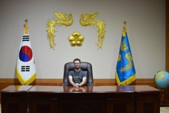 Dan sitting behind a replica of the President's desk.