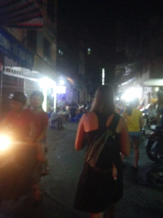Walking the streets at night in Hanoi.