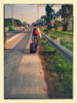 Dan walking down a highway outside of Hanoi.